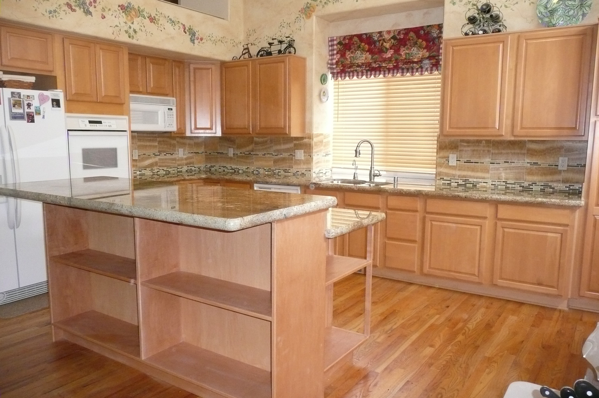 7 things to consider before refinishing your kitchen for Can you paint non wood kitchen cabinets